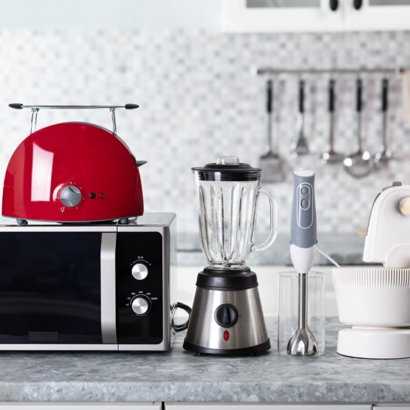 Close-up Of Home Appliance Arranged On Kitchen Worktop
